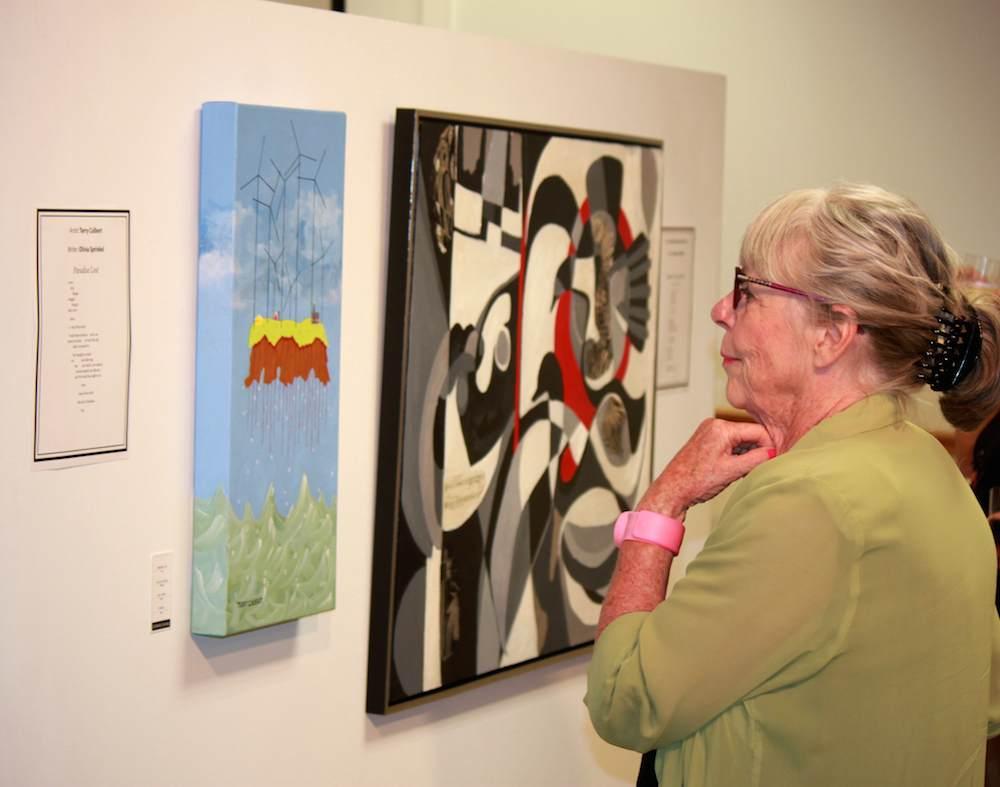 Margaret McFetridge admiring Terry Culbert's and Amelie de Koenig's work